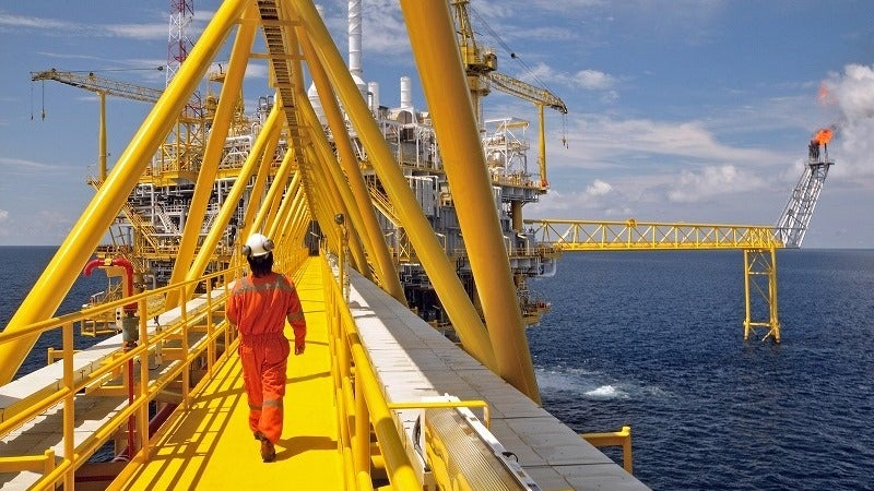 man walking on oil rig