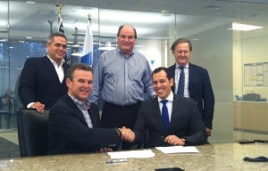 The team signs the documents at Intermarine's Houston office.
