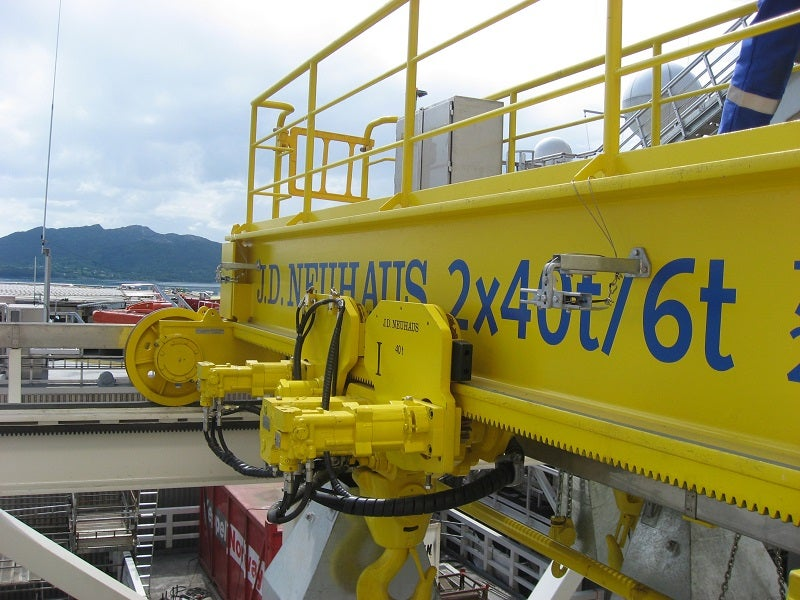 A J D Neuhaus hydraulic crane with 80t lift capacity, with rack and pinion drive mechanism for offshore application.