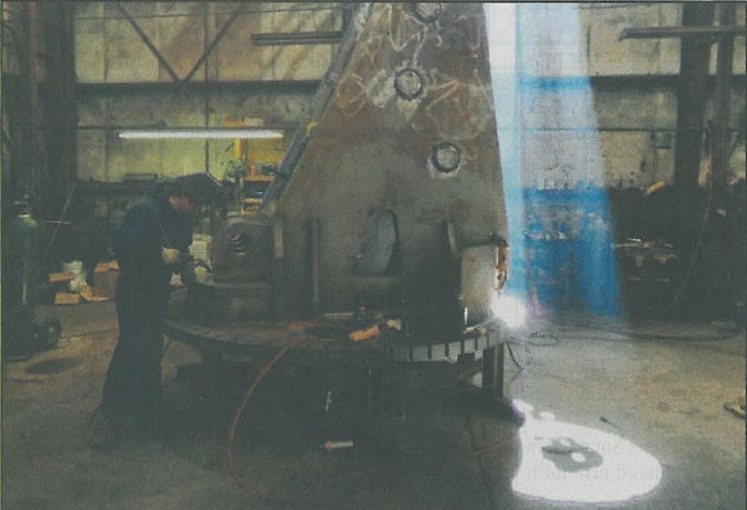 A worker at the North Pacific Crane Co. in Carson welds part of a crane