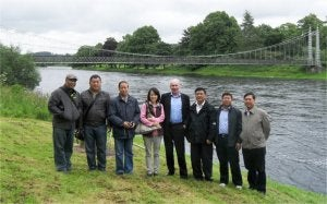 John Evans shows Chinese delegates around the Red Rooster site in Aberdeen.