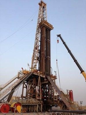 Oil-based mud drill cuttings treatment