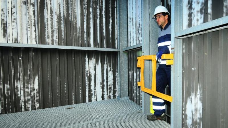 man operating safety gate